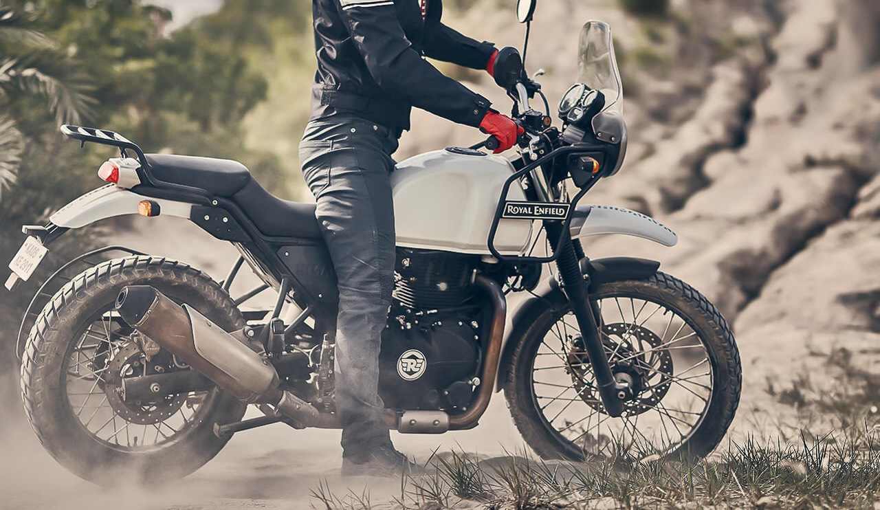 Rider with red gloves on Royal Enfield Retro Adventure Motorcycle