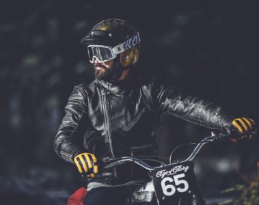Age of Glory Yellow-Black Gloved Hands on Motorcycle Handlebars