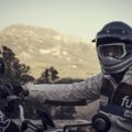Rider wearing white Fuel Rally Raid Motorcycle Jacket