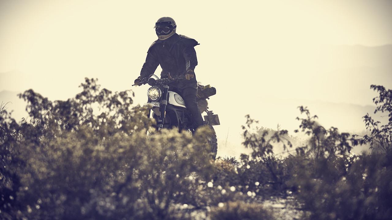 Rider on a Ducati Scrambler wearing El Gringo Jacket