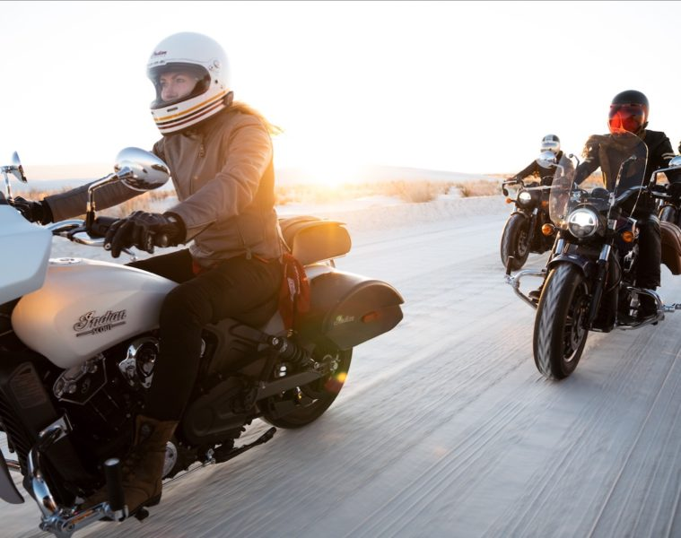 Motorcyclists riding on Indian bikes on a desert road