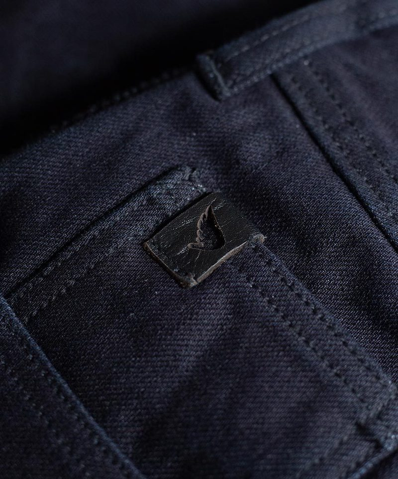 Leather tab Saint Jeans - close-up