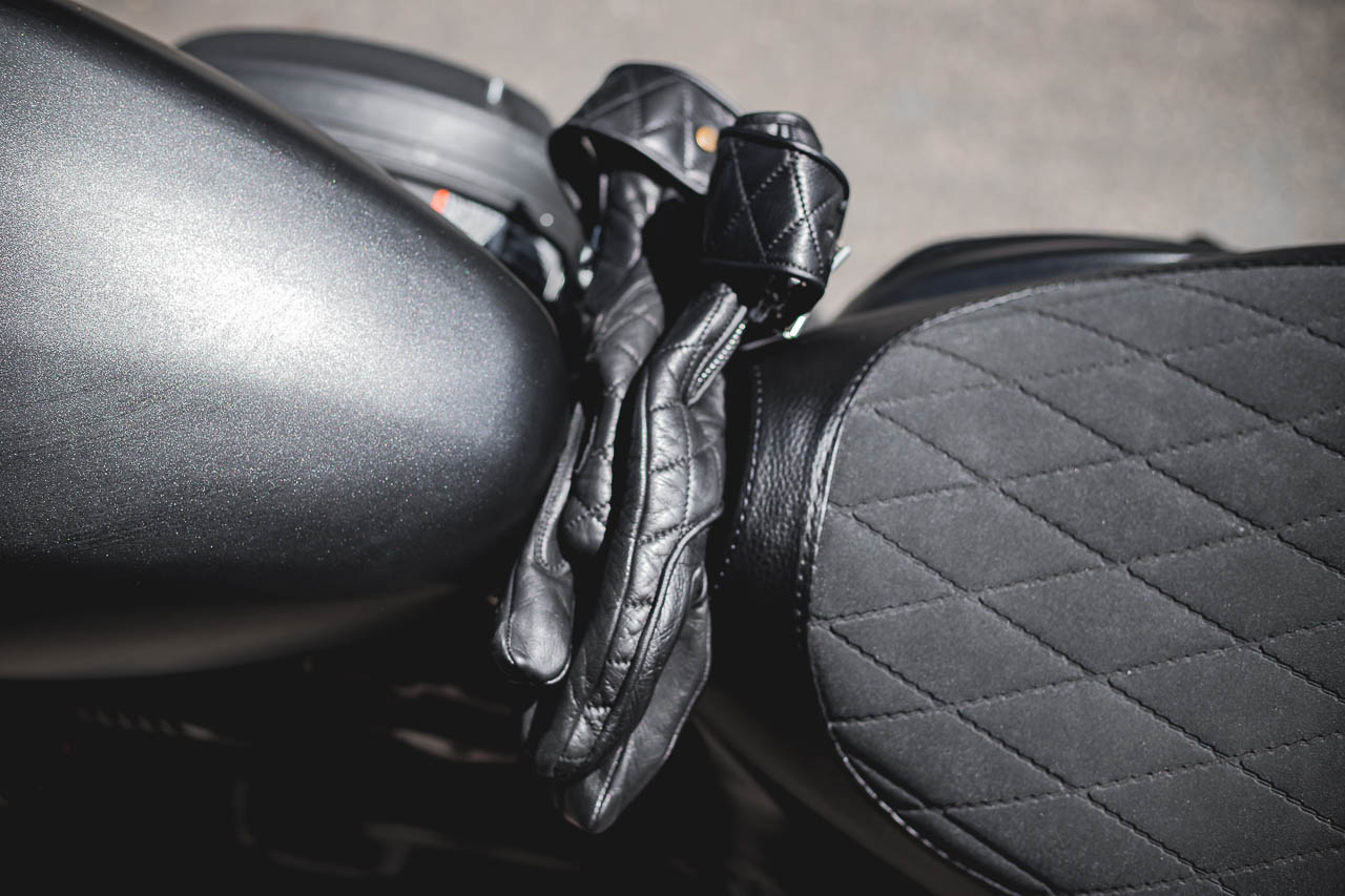 Goldtop England gloves wedged in the gap between the fuel tank and the seat. Image: Nate Kwarteng