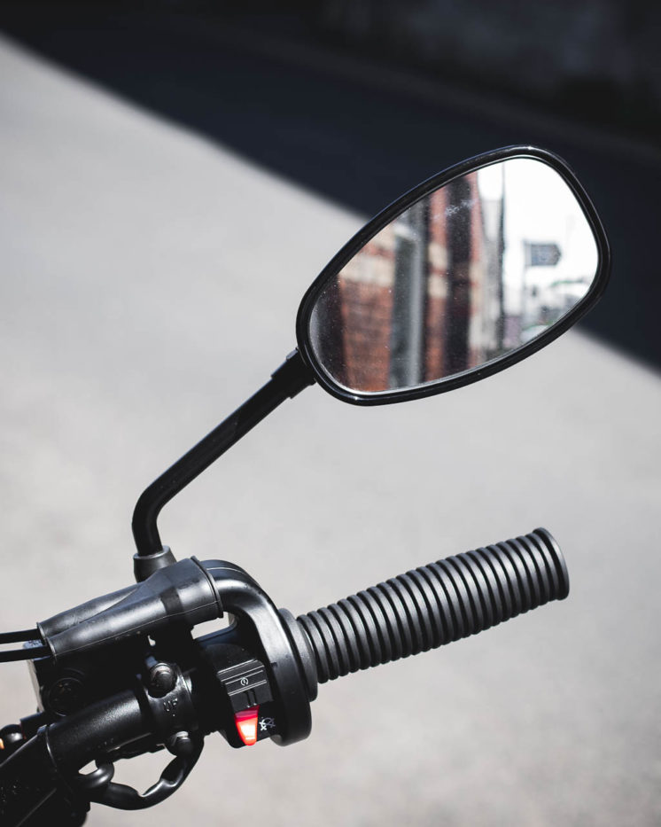 Reflection of a building in the mirror of the Aquila GV125s.
