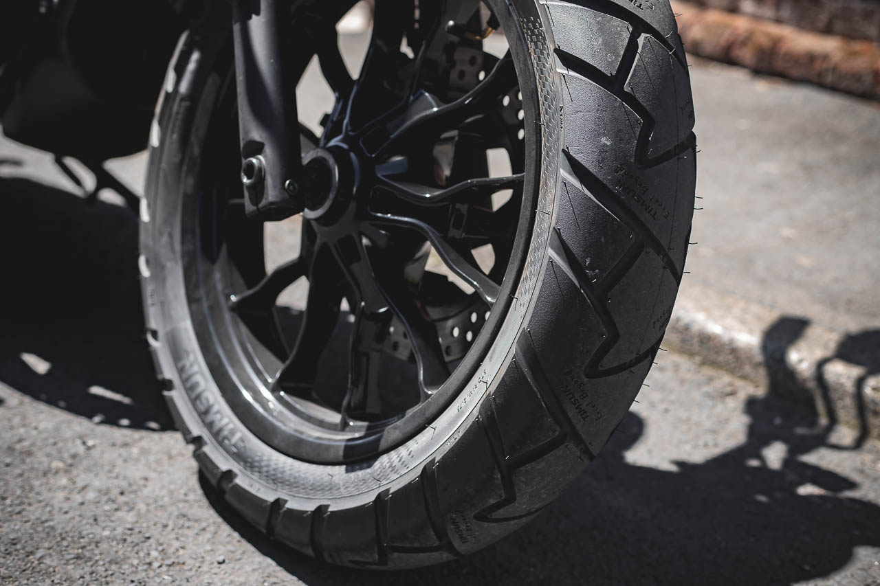 Chunky (120/80) front tyre on the Aquila GV125S.